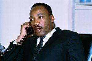 Close up of Dr. Martin Luther King Jr., on the phone after delivering a sermon at the Washington Episcopal Cathedral.