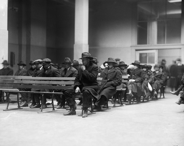 Anarchists, communists, and radicals who were rounded up in New York City during the Palmer Raids in January 1929, sit waiting on benches at Ellis Island, as they await investigation and deportation proceedings.
